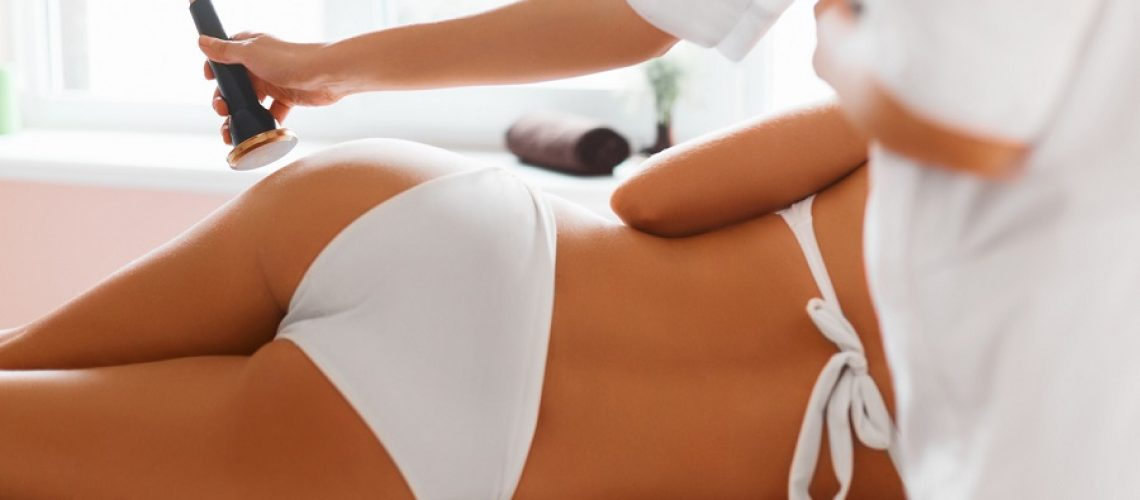Body care. Ultrasound cavitation body contouring treatment. Woman getting anti-cellulite and anti-fat therapy in beauty salon. Spa treatment.