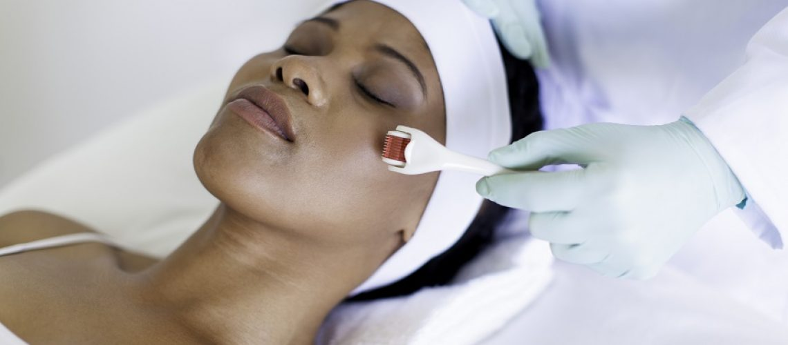 African patient getting micro-needling treatment by her doctor, Cape Town, Western Cape, South Africa